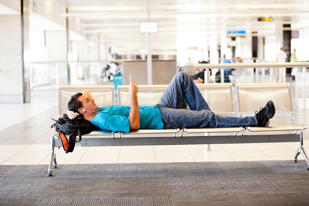 Body-guy-relaxing-in-airport